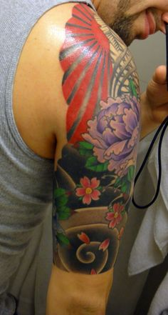 japanese tattoo. I'm generally not a fan of brightly colored tattoos, but I like this.