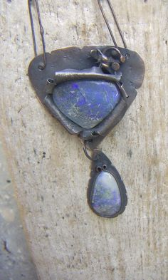 Anna is from Turkey and is owner of  Annamei rustic earthy handmade jewelry. Blue Opal in Copper Necklace on Esty $111.00 USD Only 1 available