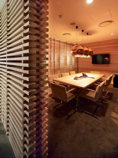 Good wall / room divider. Could combine with interesting lighting scheme.  Conference Room