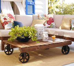 pallet coffee table on wheels resembles a train cart