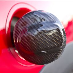 Carbon Fiber Fuel Cap Overlay for MINI Cooper. Designed for R55-R59 models.