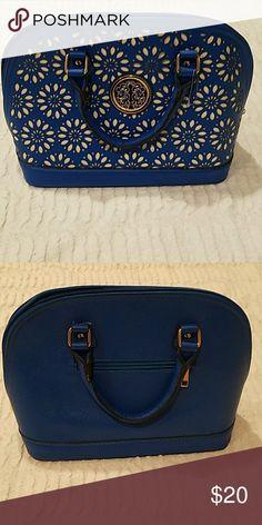 Blue Lazor Cut Floral Design Handbag Never used. Very unique bag, lovely for Spring. Bags Satchels