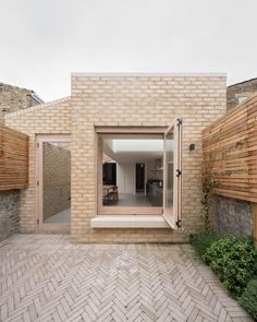 Buff brickwork with cast concrete window seat. Douglas fir bifold doors and joinery. Herringbone brick patio with cedar fencing. Rear and side extension in Camberwell, London / Oliver Leech Architects / Vestry Road Brick Extension, House Extension Design, Rear Extension, House Design, Design Homes, Residential Architecture, Architecture Design, Stockholm Design, Side Return Extension