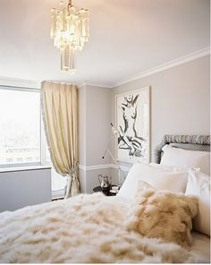Beautifully decorated room from the calming color to the soft textures on the bed. Love this!