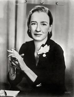 """""""Dr. Grace Hopper, director, Systems Research, Remington Rand, half-length portrait, seated, smoking cigarette."""" The pioneering computer programmer and Navy admiral (1906-1992), who is the subject of today's Google Doodle marking her 107th birthday. New York World-Telegram & Sun Collection"""
