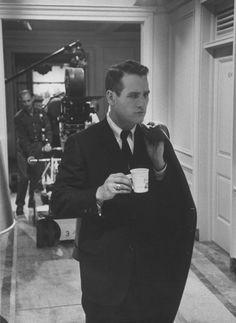Paul Newman drinking coffee on set