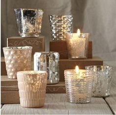 blown mercury votive holders are romantic. double the glow with this assortment of candles that reflect and refract candlelight. group them together on a dinner table to show the food and cherished guests in their best light. Votive Candle Holders, Votive Candles, Glass Votive, Silver Candles, Mercury Glass Centerpiece, Mercury Glass Candle Holders, Cheap Candles, Candle Cups, Candle Holders Wedding