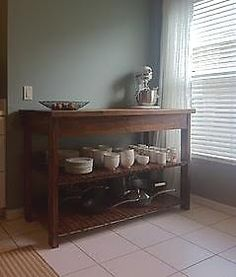 DIY Kitchen Island: Directions Here.  http://ana-white.com/2011/02/easy-kitchen-island-plans.  Great example of it done here-->http://ana-white.com/2011/07/kitchen-island