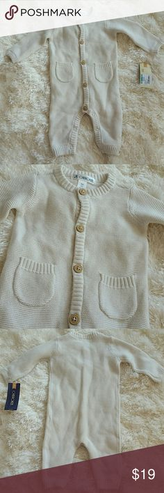 Brand new Sweater coverall size 3M Brand new with tags   So cozy and warm knitted baby sweater coverall Button up front/snap buttons on bottom, natural color, pocket detail on front. Size 3M  Bundle to save on shipping   *Boy, girl, baby, new born, baby shower gift, sweater, pullover, cream, white, footies, bodysuit Cherokee One Pieces