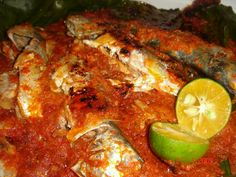 'Portuguese Malaysian Fusion Baked Fish' | Oil, onions, garlic, 2 lemongrass (halves), 6-8 tbsp red capsicum + eggplant paste (grill, blend) or chilli paste, 4-5 kaffir lime leaves, 1 small cube shrimp paste (belacan). Covered, cook few mins. Salt, sugar to taste, 1 tbsp sweet dark soy sauce. Off heat. Pour the sauce onto little salted fish (which will be covered by banana leaves & aluminium foil later). Bake it till the fish is cooked (eyes turn white). Squeeze some lime juice over.