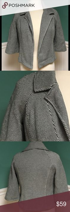 Michael Kors Striped Herringbone Jacket Very good condition, black/white striped herringbone patterned Open jacket (no front closure). 3/4 sleeves, crop style, dry clean only. Shell is 100% cotton, lining is 100% polyester. Michael Kors Jackets & Coats