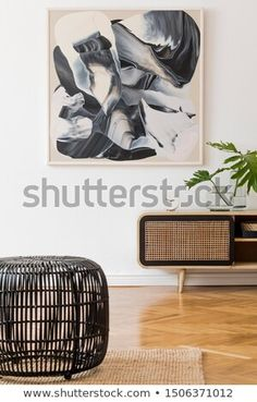 Stock Photo: Stylish scandinavian living room interior with modern wooden commode, black rattan basket, tropical leaf in vase and elegant personal accessories. Mock up paintings on the white wall. Scandinavian Interior Living Room, Room Interior, Rattan Basket, Tropical Leaves, White Walls, Decoration, Template, Paintings, Vase