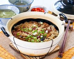 Claypot Chicken Rice is a delicious one-pot meal that can be easily prepared at home. The addition of mushrooms and Chinese sausage makes it even tastier.   RotiNRice.com