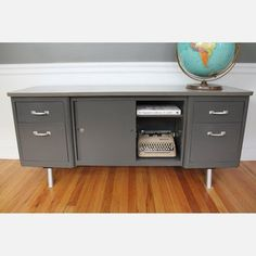 Is brown instead of gray, and has a door instead of drawers on one side, and 3 drawers on the other.