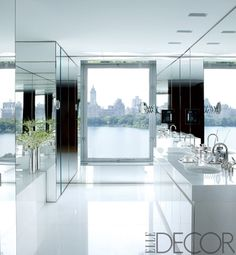 Master bathroom. Mirrored and white lacquer cabinetry. Countertop. Thassos marble floor. View of Central Park Reservoir. Celebrity homes. Ralph Lauren.