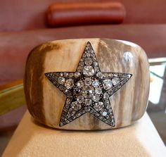 "Missy, like the great Coco Chanel and the incomparable Diana Vreeland ""armed"" herself with Verdura cuffs...  [Shown here:  Verdura cuff with star brooch]"