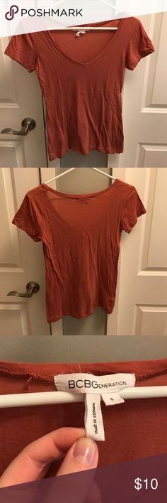 Very Soft Burnt Orange V-Neck Tee Very soft burnt orange colored V-neck Tee. Great basic top. BCBGeneration Tops Tees - Short Sleeve