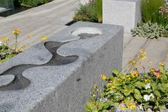 Family friendly water feature with a rill etched into the top of a granite wall (Chelsea, 2014, by LDC design).