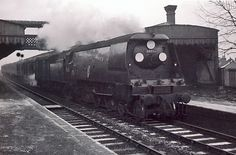 Photo of Bulleid Battle of Britain Class pacific number 34055, Fighter Pilot, passing Selsdon station with a Brighton to London train, most likely the 07.35 ex Brighton, (via Oxted at 09.11), probably in winter 1961/62