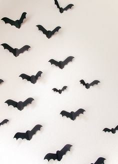 Make a minimal photo booth backdrop for your Halloween party with some bats on your wall.