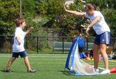 Matthew with the goal and Coach Emily with the High-Five!