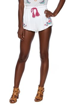 White gauzy shorts with an elastic drawstring waist with a pink fringed drawstring and colorful embroidery on the legs.    La Lune Shorts by MinkPink. Clothing - Shorts - Mini Clothing - Matching Sets New York