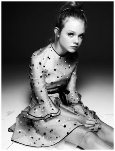 Elle Fanning Photographed by Steven Pan for Interview magazine January 2011 | cute spotted frilly dress | fashion editorial | black & white photography | bored | waiting | disinterested | spots | dots | ladylike