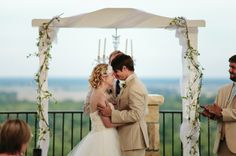 Lawrence, KS family, wedding, lifestyle, engagement, photojournalistic, photographers, rooftop wedding, classy, elegant, hotel, ceremony, overlook, flowers, dress, bride, groom, sweet, cute