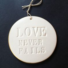 LOVE NEVER FAILS ornament with gold leaf rim | Paloma's Nest