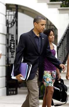 President Barack Obama, walks with daughter Malia Obama, 11, from the White House to board Marine One which would take them to Andrews Air Force Base to catch Air Force One.