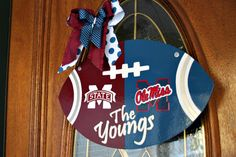 Just added this #hand-painted #football #door hanger to my #Etsy shop.  It is a #house-divided #personalized #Mississippi State and #Ole Miss #football.  We can make any teams for you!  Check it out on my Etsy shop.