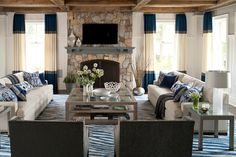 Living room with color block curtains, a stone fireplace, dueling facing sofas, exposed beam ceilings, and a large coffee table Sofa Living, Cozy Living Rooms, Living Room Grey, Living Spaces, Living Room Decor, Small Living, Modern Living, Living Area, Living Room Furniture Layout