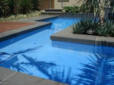 Blue stone pool coping tiles and outdoor pavers Modern Landscape Design, Landscape Materials, Modern Landscaping, Outdoor Landscaping, Pool Coping, Outdoor Pavers, Outdoor Flooring, Bluestone Paving, Swimming Pool Enclosures