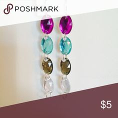 Color Blocked Earrings Color blocked long dangling earrings. Colors on it include purple, turquoise, olive green and silver. Two available in stock. Other color combinations also available. Jewelry Earrings