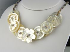 Carved Mother of Pearl Button Necklace. One of a Kind carved flower button necklace.    www.trinketsnwhatnots.etsy.com