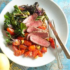 Sear steaks in a hot skillet to reach a lovely medium-rare finish in just 10 minutes. Plate with sauteed kale sprouts and tomatoes to round out the meal.