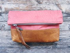Super soft coloured leather on leather make this the perfect clutch or luxury cosmetic bag...    ~ 9.5 x 10.5 ~ Super soft distressed pink