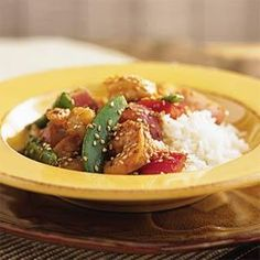 This stir-fry dish is ready in 11 minutes and features shrimp, snow peas, and is served with rice.