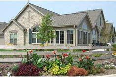 Stone & siding with brick accents wrap two walls of expansive windows. The Glen of Brookfield from Cornerstone Development. Brookfield, WI.