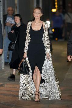 In a black Nanushka slip dress, Stuart Weitzman sandals, a black handbag and cheetah print silk robe while out in New York City.