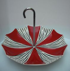 midwinter zambesi umbrella cake stand, hey it is an umbrella, could not help pinning it.