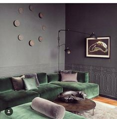 1st: the green couch. 2nd: the purple pillows (both the foreground, And the one in the back corner.). 3rd: the painting. 4th: the circular art installation on the wall. 5th: the cool wainscoting of the back wall. #EclecticDecor