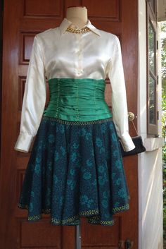 A personal favorite from my Etsy shop https://www.etsy.com/listing/290139119/vintage-corset-drapped-skirt