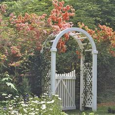 This arbor boasts of a gate that covers the lower half, allowing visitors to see into the garden. The gate adds a sturdier look to the graceful arch and trellis of the arbor. Ensure that your gate works the way you want it to by having its bottom high enough to avoid any obstructions.