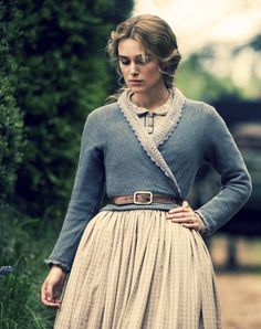 I've been such a sucker for any sweater or wrap around blouse... beautiful with a belt over it.... just like in this picture- it takes me back to 1800s beauty