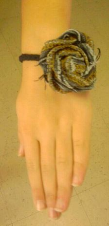 My version of the rosette bracelet linked to this. I made it w/strips braided together from my grandad's old t-shirt & the inseam of my daughter's old jeans for the flower.
