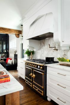 The clients purchased the gorgeous La Cornue stove before the remodel, but despite the French dimensions, it was easy to design into the new...