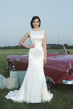 2014 Bateau Mermaid Wedding Dress Beaded And Ruffled Chapel Train Satin. May be a tad plain for you Ange, but it's elegant.