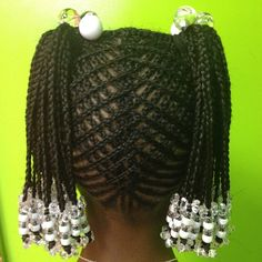 Wow! This is an intricate cornrow design. Would you have the patience to do this? Better yet, take these down?