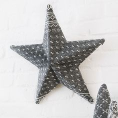 Sweatered Star      Cover a plain-Jane cardboard star (available at crafts stores) with a wool sweater. Trim the sweater slightly larger than the star and hot-glue the sweater edges to the back. A bit of embroidery floss makes a nice hanging loop.